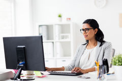 Happy businesswoman with computer at office stock photos