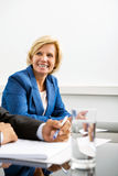 Happy Businesswoman In Conference Room Royalty Free Stock Images