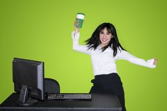 Happy businesswoman is dancing with coffee stock images