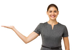 Happy Businesswoman Displaying Invisible Product Royalty Free Stock Photos