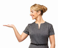 Happy Businesswoman Displaying Invisible Product Royalty Free Stock Images