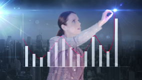 Happy businesswoman drawing hologram graph with city on background stock video