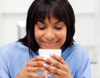 Happy businesswoman drinking a coffee Royalty Free Stock Photo