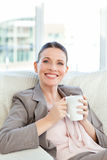 Happy businesswoman drinking a cup of coffee Royalty Free Stock Photos