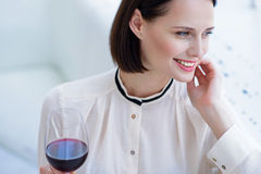 Happy Businesswoman Enjoying Red Wine Stock Photo
