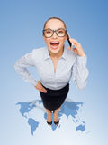 Happy businesswoman in eyeglasses with smartphone Stock Images