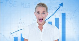 Happy businesswoman in front of a board with arrows and graphics stock image