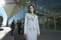 Happy Businesswoman In Front Of Office Building Royalty Free Stock Images