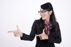 Happy businesswoman gesturing isolated on white. Smiling Asian businesswoman gesturing shot in studio Royalty Free Stock Photography