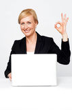 Happy businesswoman gesturing okay sign Royalty Free Stock Photography
