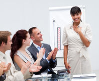 Happy businesswoman after giving a presentation Royalty Free Stock Images