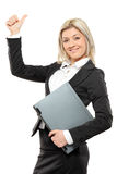 Happy businesswoman giving thumbs up Royalty Free Stock Image