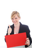 Happy businesswoman giving a thumbs up Royalty Free Stock Photography