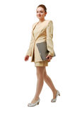 Happy businesswoman going with notebook PC. Royalty Free Stock Images