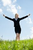 Happy Businesswoman In Grassland Royalty Free Stock Photos