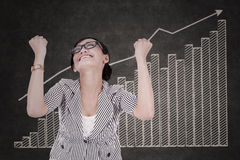 Happy businesswoman with growth graph Stock Images