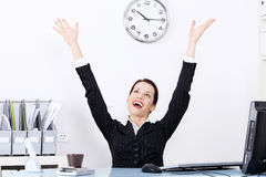 Happy businesswoman with hands in the air. Stock Image