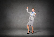 Happy businesswoman with hands up Stock Photography