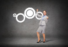 Happy businesswoman with hands up Stock Images