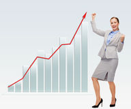 Happy businesswoman with hands up Stock Image