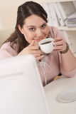 Happy businesswoman having coffee break at office Stock Image