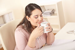 Happy businesswoman having coffee break at office Royalty Free Stock Images
