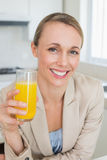 Happy businesswoman having orange juice before work in the morning Royalty Free Stock Photography