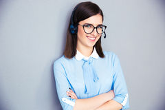 Happy businesswoman with headset and arms folded Royalty Free Stock Photography