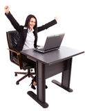 Happy businesswoman at her desk Stock Photo