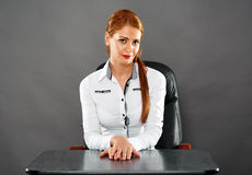 Happy businesswoman at her desk Royalty Free Stock Photography