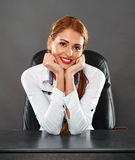 Happy businesswoman at her desk Stock Image