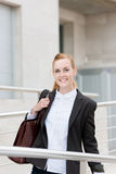 Happy Businesswoman On Her Way To Office Stock Photo