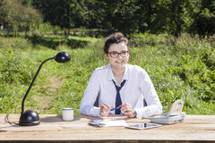 Happy businesswoman in his office in the park. Happy business woman in his office in the park Royalty Free Stock Image