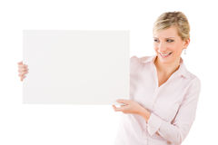 Happy businesswoman holding aside empty banner Royalty Free Stock Photo