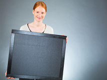 Happy Businesswoman Holding a Blackboard Stock Image