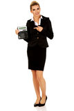 Happy businesswoman holding a calculator Stock Photo