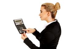 Happy businesswoman holding a calculator Stock Photography