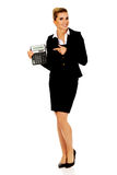 Happy businesswoman holding a calculator Royalty Free Stock Photo