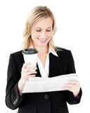 Happy businesswoman holding coffee and newspaper Stock Image