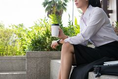 Businesswoman holding coffee outside office building. beautiful Stock Images