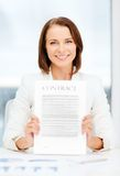 Happy businesswoman holding contract Royalty Free Stock Image