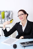 Happy businesswoman holding credit card. Royalty Free Stock Photos