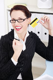 Happy businesswoman holding credit card. Stock Image
