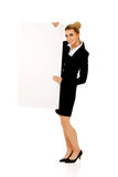 Happy businesswoman holding empty banner. Royalty Free Stock Photo