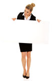 Happy businesswoman holding empty banner. Royalty Free Stock Photography