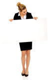 Happy businesswoman holding empty banner. Royalty Free Stock Photos