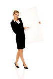 Happy businesswoman holding empty banner. Stock Image