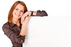 Happy Businesswoman holding empty billboard Stock Images