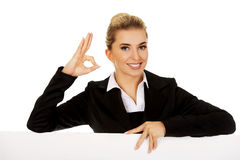 Happy businesswoman holding empty billboard Royalty Free Stock Photography