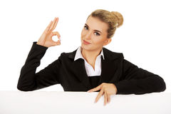 Happy businesswoman holding empty billboard Stock Photo